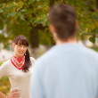 Smiling girl behind blurry boy — Stock Photo
