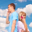 Couple talk on cell phones — Stock Photo