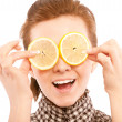 Woman holding lemon near her eyes — Stock Photo
