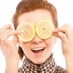 Woman holding lemon near her eyes — Stock Photo #2871186