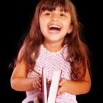 快乐的年轻女孩与红色的书 — 图库照片
