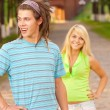 Loving young couple playing outside - Stock Photo