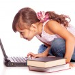 Young girl with computer — Stock Photo