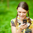 Young woman using her phone — Foto Stock