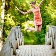 Royalty-Free Stock Photo: Jump girl on summer bridge