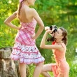 Girl photographer shoot model — Stock Photo
