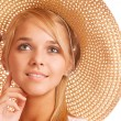 Girl wearing straw-hat portrait - Stock Photo