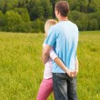 Couple standing and hugging in nature — Stock Photo