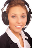 Woman-distpetcher with ear-phones — Stock Photo