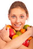 Girl holds fruit — Stock Photo