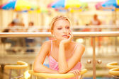 Girl reflects in cafe — Stock Photo