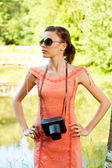 Young girl with camera — Stockfoto