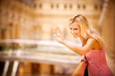 Young woman waves hand — Stock Photo