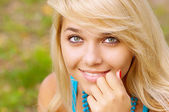 Beautiful blond woman outdoors — Stock Photo