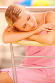 Girl has fallen asleep on chair — Stock Photo