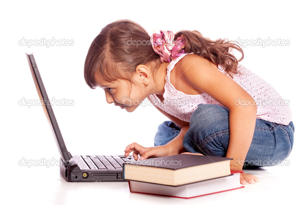 Young girl with computer and books, isolated on white background.  Stock Photo #2871262