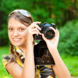 Young girl with camera - Stock Photo