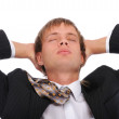 Young businessman has rest in armchair — Stock Photo