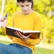 Young student holding books — Stockfoto