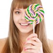 Young girl and lollipop — Stock Photo
