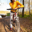 Stock Photo: Beautiful girl riding bicycle