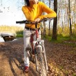Beautiful girl riding bicycle - Stock Photo