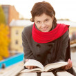 Young woman with book - Stock Photo
