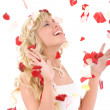 Beautiful laughing bride. On her petals of roses — Stock Photo