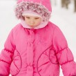 Sad preschool child in pink coat — Stock Photo