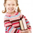 Nice preschool child holds textbooks — Stock Photo