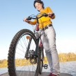 Beautiful girl riding bicycle — Stock Photo #3247123