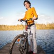 Beautiful girl riding bicycle — Stock Photo #3247126