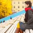Girl with red scarf at stadium - Stock Photo