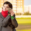 Girl with red scarf looks in mirror — Stock Photo