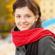 Beautiful girl with red scarf — Stock Photo #3247190