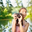 Young girl with camera — Stock Photo
