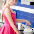 Girl in red dress holds teapot - Lizenzfreies Foto