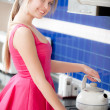 Girl in red dress holds teapot - Stockfoto
