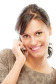 Morena sonriente habla por teléfono móvil — Foto de Stock