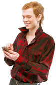 Young man dials number on phone — Stock Photo