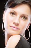 Portrait of dark-haired young woman close up — Stock Photo