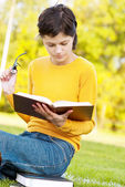 Young student holding books — Stock Photo