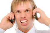 Angry businessman shouts in two phones — Stock Photo