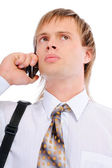 Sad businessman talks on cellular telephone — Stock Photo