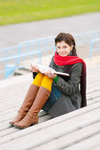 Beautiful young woman reads book — Foto de Stock