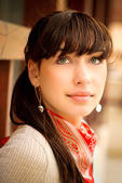 Beautiful girl with kerchief on neck — Stock Photo