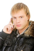 Man in winter jacket speaks on phone — Stock Photo