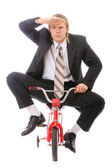 Businessman goes on children's bicycle — Stock Photo