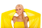 Beautiful smiling woman in yellow dress — Stock Photo