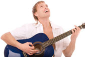 Beautiful young man plays guitar — Stock Photo